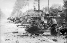 The wreckage of the British transport column, and an anti-tank gun, that Wittmann engaged.