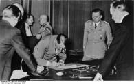 Hitler signing the Munich Agreement.