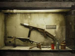 Polish insurgent weapons, including the Błyskawica submachine gun—one of very few weapons designed and mass-produced covertly in occupied Europe.