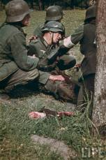 Badly injured comrade getting medical attention.