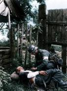 Medic on site first aid aid for a wounded comrade.
