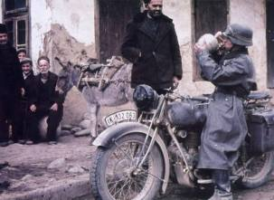 Bulgarian civilian giving water to a army motocyclist in Bulgaria 1942.