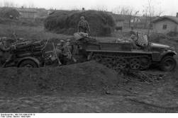A 28/32 cm Nebelwerfer 41 launcher towed by a Sd.Kfz. 10/1 half-track.