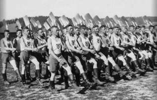 Members of the Reich Labor Service at work, circa 1940. This state-run labor program both helped lessen the effects of unemployment and create a Nazi-indoctrinated workforce, requiring each young man to serve for a six-month period.
