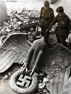 Reichsadler from the Reich Chancellery - 1945 with Soviet soldiers inspecting it.