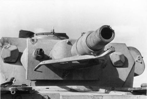 A Panzer IV Ausf. E showing signs of multiple hits to the turret, including the gun barrel.
