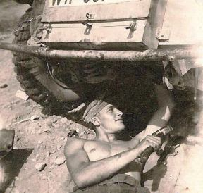Mechanic working on the vehicle in the deserts of North Africa.