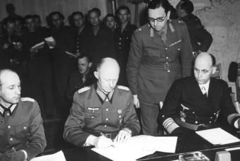 German Col. General Alfred Jodl signs the Instrument of Surrender at Reims, France, May 7, 1945.