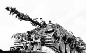 Close up view of Panther crew being transported with their tank to France in June 1944.