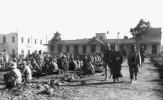 Rommel walks past Allied prisoners taken at Tobruk in 1942.