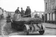 Marder I towing its ammunition trailer.