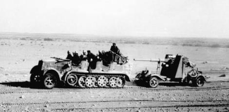 Sd.Kfz 7 bringing forward an 8.8 cm Flak gun in 1941.
