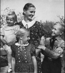 A family gazes lovingly at their boy, a member of the Hitler Youth, February 1943.