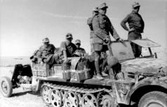 Flak unit pulling a 37 mm anti-tank gun comes to a halt.