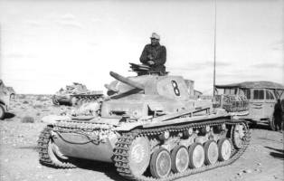 A Panzer II of the Afrika Korps. Note the faded insignia on the front, left of the handle and just below the turret.