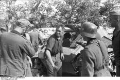 German soldiers loading ammunition from a Sd.Kfz 252, Crimea, June 1942.