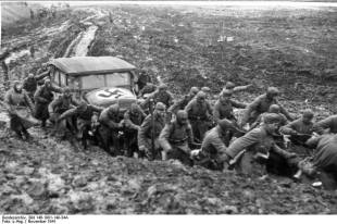 Wehrmacht soldiers pulling a car from the mud during the rasputitsa period, November 1941.