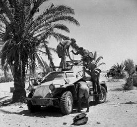 British soldiers inspect a captured SdKfz 222, North Africa, 1941.