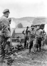 December 19,1944. Off to the left in the photo is SS Capt. Josef Diefenthal leading the SPW battalion in Peiper's advance.