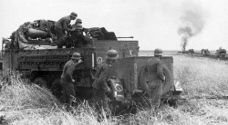 Soldiers use a 20 mm PAK on a special motor vehicle.
