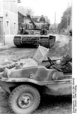 """Tiger I """"(tower number 133) of the first SS-Panzer-Korps """"Leibstandarte Adolf Hitler"""" in town before business """"Nieuverburg"""" in the foreground floating bucket, PK 698."""