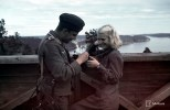 Air-observation Lotta Eillen Kiuru posed for a propaganda picture in front of Finnish and German war correspondents at Lahdenpohja observation tower on 11 July 1942. The women of Finland fulfilled numerous important roles, even near the front line. 'Lotta Svärd' was a Finnish voluntary auxiliary paramilitary organisation for women.