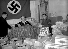 Volunteers gather Christmas donations for the poor in Berlin, December 1935.