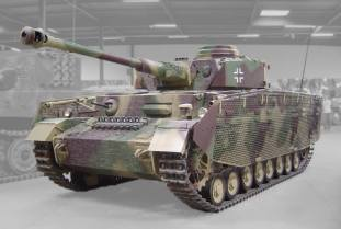 A Panzer IV Ausf H at the Musée des Blindés in Saumur, France, with its distinctive Zimmerit anti-magnetic mine coating, turret skirts, and wire-mesh side-skirts.
