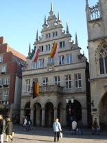 The Stadtweinhaus in Münster with banners displayed in mourning (note the black ribbons atop each mast) after the death of former German president Johannes Rau in 2006.