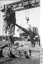 Installing a turret in a Tiger 1 in the field.