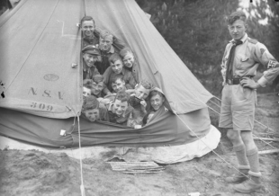 Hitler Youth members camp out in a tent at an unspecified location, 1933.