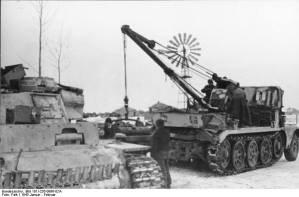 A Sd.Kfz. 9/1 hoisting a Maybach HL 120 TRM engine into a Panzer III.
