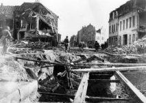 9th Army, 2nd Armored Division troops move thru Krefeld March 3, 1945.