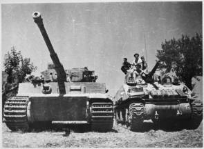 A NZ Sherman tank contrasted alongside a German Tiger tank. This Tiger was captured single handed by officers of 22 NZ Bn, in the village of La Romola.