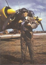 A German Luftwaffe Staffelkapitän with the rank of Oberleutnant in front of a Junkers Ju 88A bomber during the Balkan campaign, spring 1941. Staffelkapitän is a position (not a rank) in flying units (Staffel) of the German Luftwaffe that is the equivalent of RAF/USAF Squadron Commander.