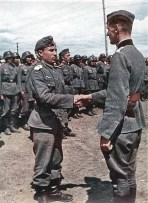 A Wehrmacht officer welcomes a Cossack into his unit.