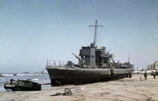 German forces move into Dunkirk hours after the evacuation of the British Expeditionary Force was completed. A beached French coastal patrol craft at low tide at Dunkirk.