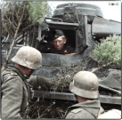 A crew member of a Panzer Mk. III Ausf.J chats with two Grenadiers, Spring 1942.
