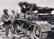 Apweiler, Germany, Winter 1945. US combat engineers ready a Panzer IV for demolition to stop any chance of it falling back into enemy hands.