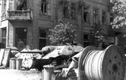 Barricade erected such on Napoleon Square. In background: captured Hetzer tank destroyer. 3 August 1944.