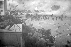 Feature film re-enactment of British troops under fire on the beach at Dunkirk.