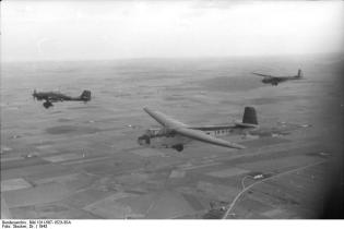 DFS 230's flying over Italy, towed by par Stuka Ju-87.
