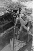 Marineartillerie-obergefreiter (to the left) (Seaman - Coastal Artillery Gunner)