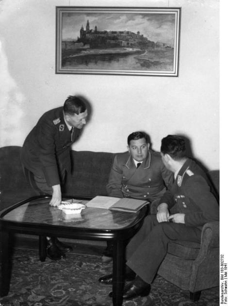 Meeting at Josef Buhler in Krakow, left Kurd Eissfeldt , Mittebuehler , right Ernst Kundt , May 1941.