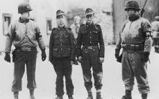 Captive young German soldiers of the 12th SS Panzer Division -Hitlerjugend under the escort of the Military Police of the 3rd U.S. Army. These guys were captured in December of 1944 during the operation in the Ardennes - January 7, 1945.