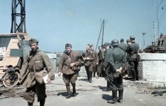 German forces move into Dunkirk. Disarmed French soldiers file pass German officers on the outskirts of Dunkirk. The evacuation of the British Expeditionary Force had been completed a few hours earlier.
