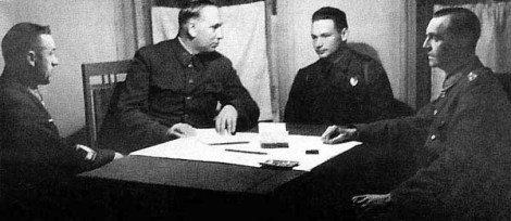 Paulus' interrogation at Don Front HQ: General Rokossovsky, Marshal Voronov, translator Nikolay Dyatlenko and Paulus (left to right).