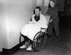 Kaltenbrunner wheeled into court during the Nuremberg trials after an illness.
