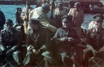 Finnish and Luftwaffe artillery officers on the boat with flak team wearing kapok schwimmweste.