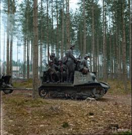 Finnish troops riding on a captured Soviet T-20 Komsomolets artillery tractor.